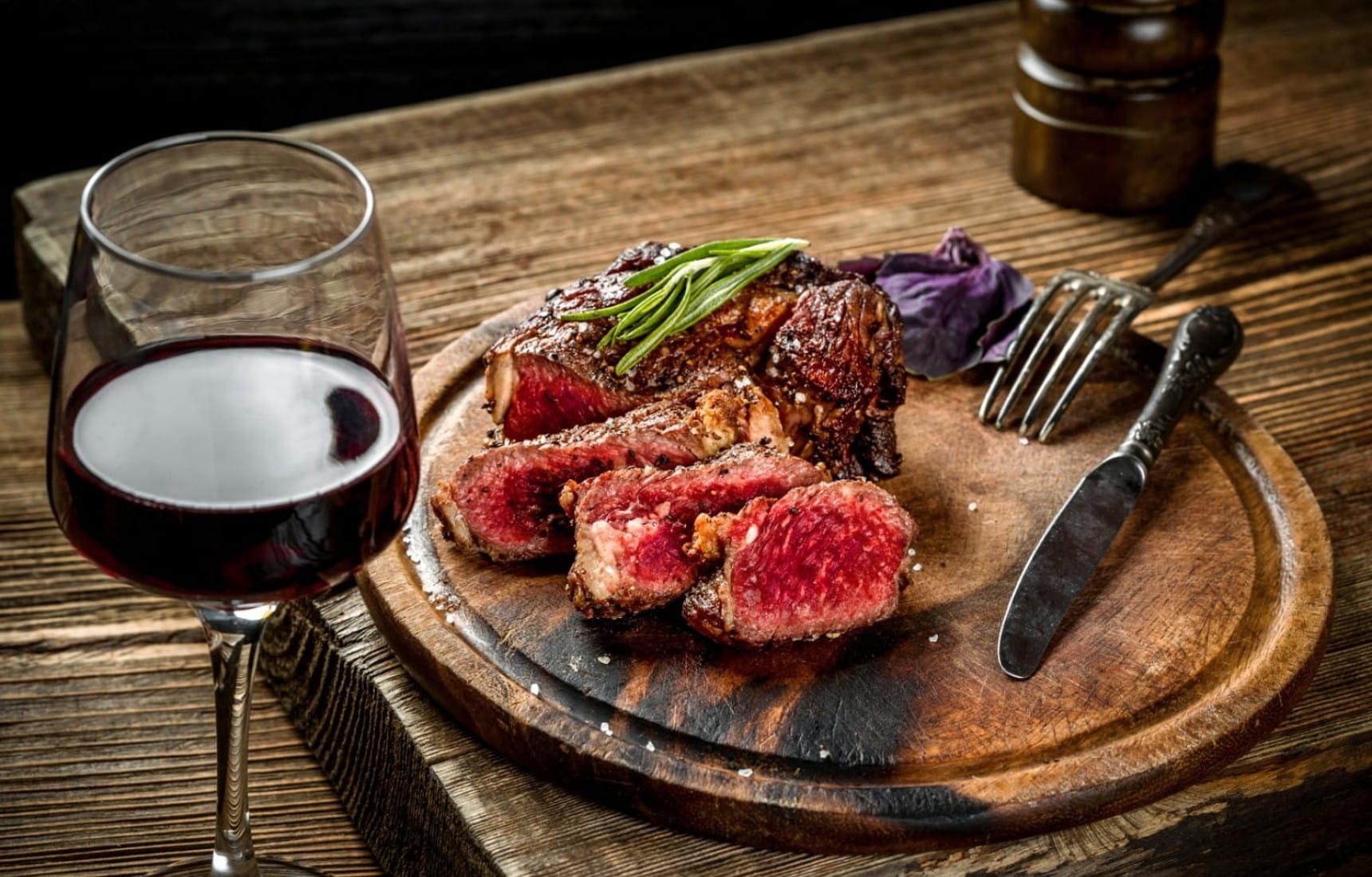 rare-steak-with-a-glass-of-cabernet-sauvignon@2x